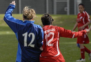 An image of two women playing a football match